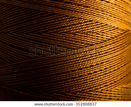 golden thread background, braided monofilament strong thread. - stock photo