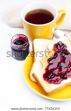 Golden toast with currant jam - stock photo