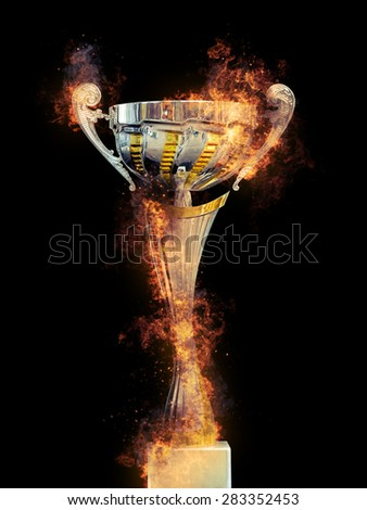 Golden trophy in fire on black background - stock photo
