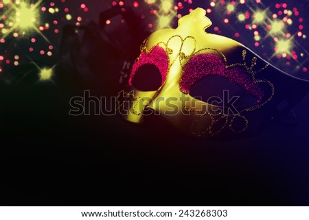 Golden venetian mask over black background. - stock photo