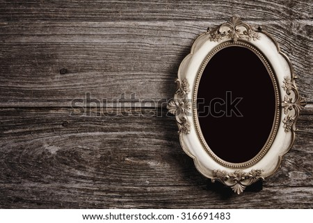 Golden vintage frame on wood texture background, Objects with clipping paths for design work - stock photo