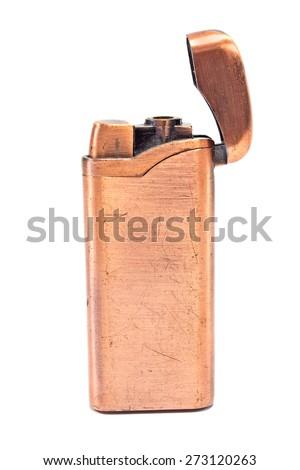 Golden vintage lighter isolated on white - stock photo