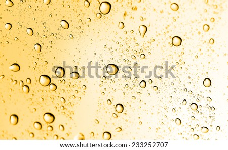 golden water drops on glass - stock photo