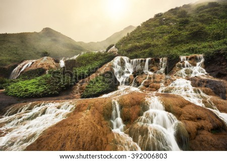 Golden Waterfall is one of the most beautiful waterfall in Taiwan. It is located at Jinguashi township, Taiwan. - stock photo