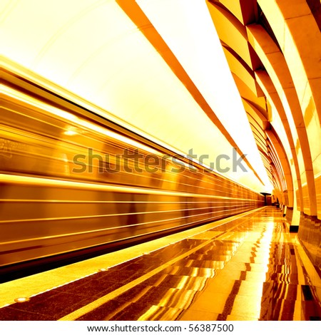 golden way of moving train in motion - stock photo