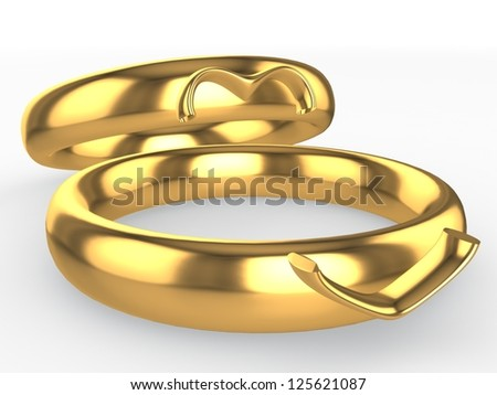 Golden wedding rings. Heart from two parts. Eternal love concept - stock photo