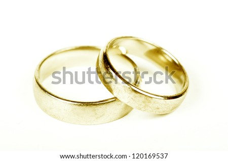 Golden wedding rings isolated on white - stock photo