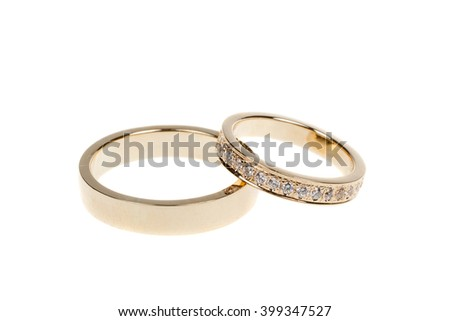 Golden wedding rings, isolated on white - stock photo