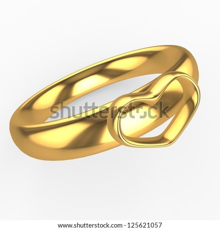 Golden wedding ringwith a heart - stock photo