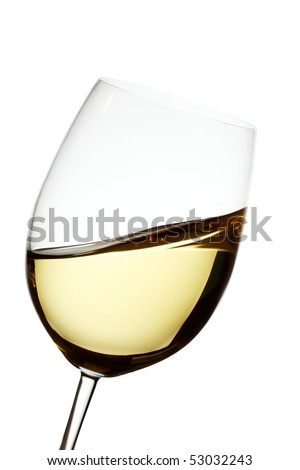 Golden white wine in a crystal glass showing waves - stock photo
