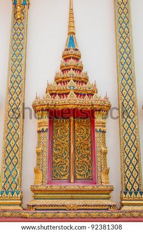 Golden window  buddhist  temple - stock photo