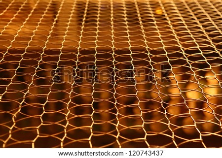 Golden wire net for security - stock photo