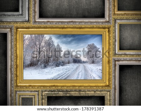 golden wooden frame with beautiful landscape among other empty frames. Photo inside frame is my property. - stock photo