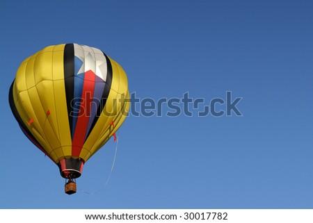 Golden Yellow Hot Air Balloon Rises - stock photo