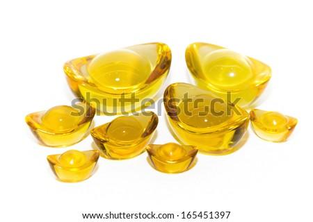 Golden yellow ingots on a white background. - stock photo