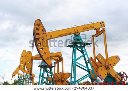 Golden yellow Oil pump oil rig energy industrial machine for petroleum crude - stock photo