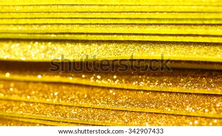 Golder Paper glitter for decorations and decoupage - stock photo
