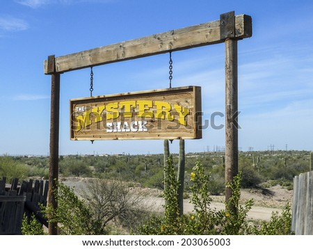 GOLDFIELD GHOST TOWN, USA -  MARCH 3, 2011: Mystery shack sign in Goldfield Ghost town, USA. Back in 1he 1890s Goldfield boasted 3 saloons, boarding house, general store, brewery and school house. - stock photo