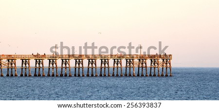 Goleta pier in the evening at sunset. - stock photo