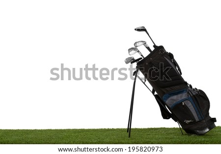 Golf bag and clubs on grass side view isolated on white - stock photo
