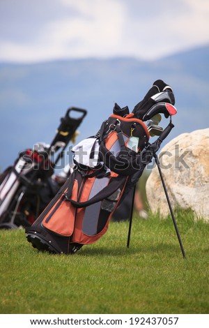 golf bag in spring green golf club grass  - stock photo