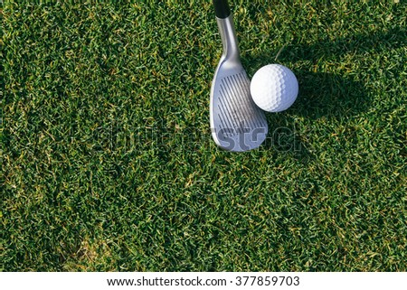 Golf ball and golf club - stock photo