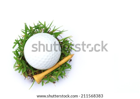 golf ball and green grass - stock photo