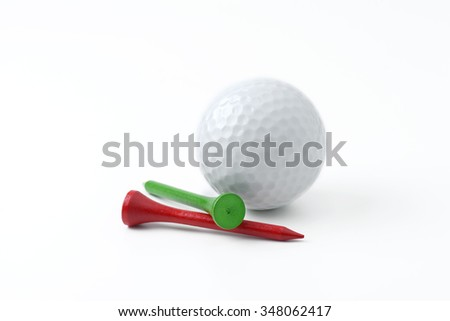 golf ball and tee on white background - stock photo