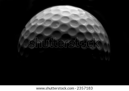 Golf ball closeup in black and white - stock photo