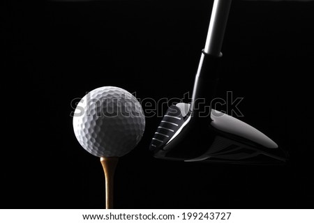 Golf ball club and tee on black background - stock photo