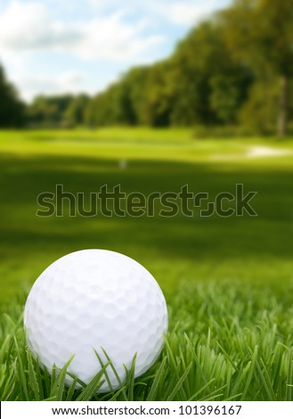 Golf Ball in Grass - Course in Background - stock photo