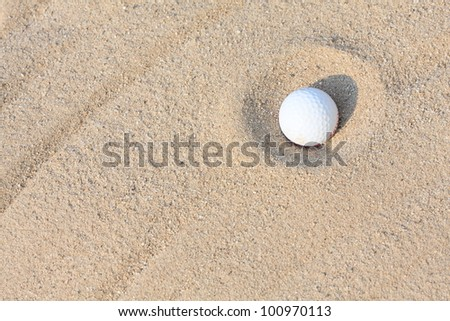 golf ball in sand bunker. - stock photo