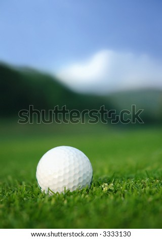 Golf ball in the middle of the fairway - stock photo