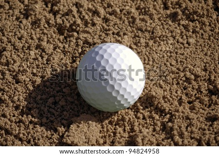 Golf ball lies in the sand trap. - stock photo