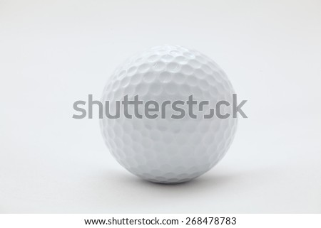Golf ball on a white surface, raw - stock photo