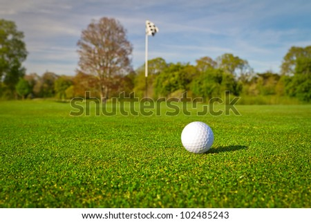 Golf ball on beautiful golf course - stock photo