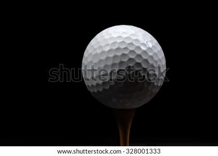 Golf ball on black background - stock photo