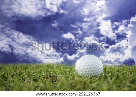golf-ball on course and sky - stock photo