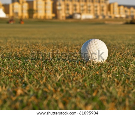 Golf ball on fairway of golf course. - stock photo