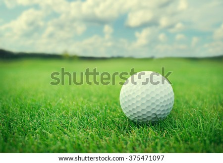 Golf ball on golf course. - stock photo