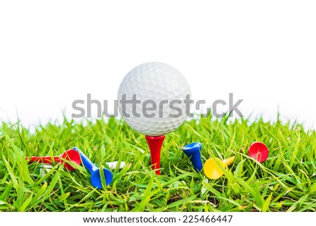 Golf ball on green grass against white background, selective focus. - stock photo