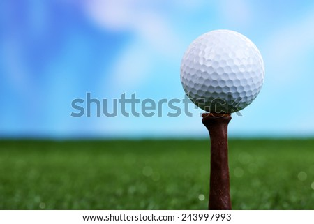 Golf ball on green grass outdoor close up - stock photo