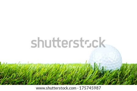Golf ball on green grass over white background - stock photo