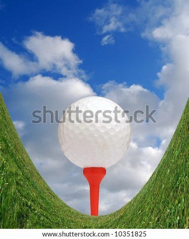 Golf ball on red tee on distorted grass - stock photo