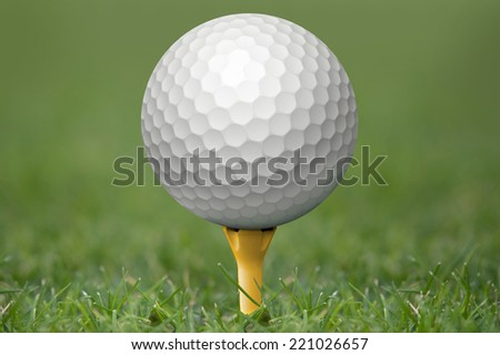 Golf ball on tee at the green. Focus on the ball.  - stock photo