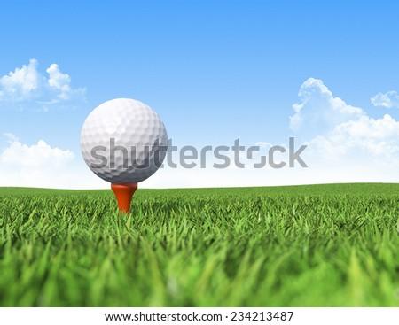 Golf ball on tee in grass - stock photo