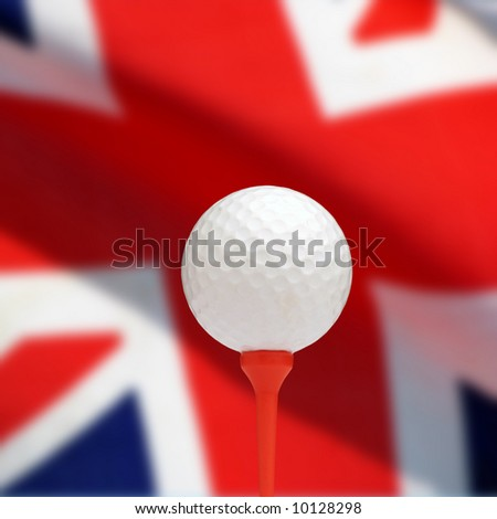 Golf ball on tee with out-of-focus Union Jack flag - stock photo