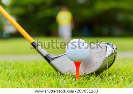 Golf ball on the green grass. - stock photo