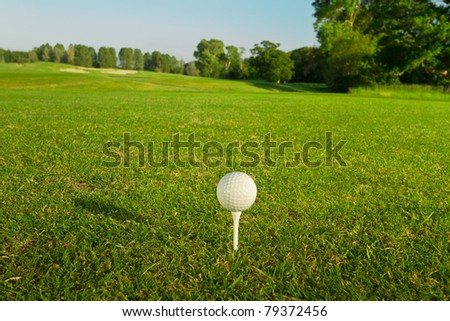 Golf ball on the tee - idyllic golf course of Adare - stock photo
