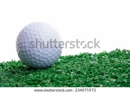 Golf ball ower green grass - stock photo